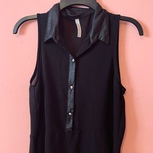 Black sleeveless button-up collared blouse